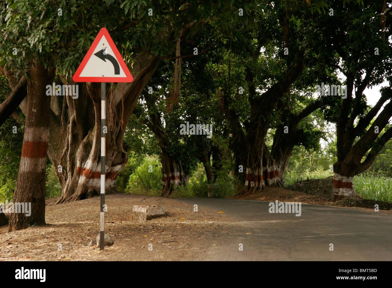 Road sign indicating left turn on the way of Wai; Maharashtra; India - Stock Image