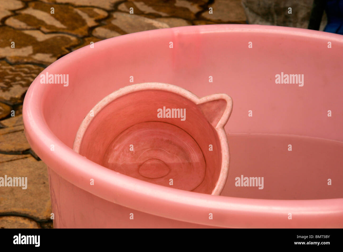 Abstract of  pink bucket showing circular patterns - Stock Image