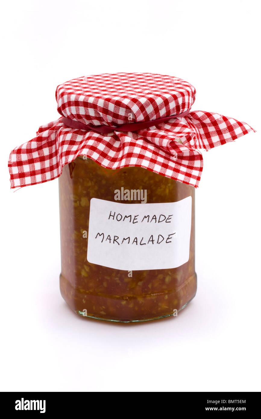 jar of homemade marmalade on a white background - Stock Image