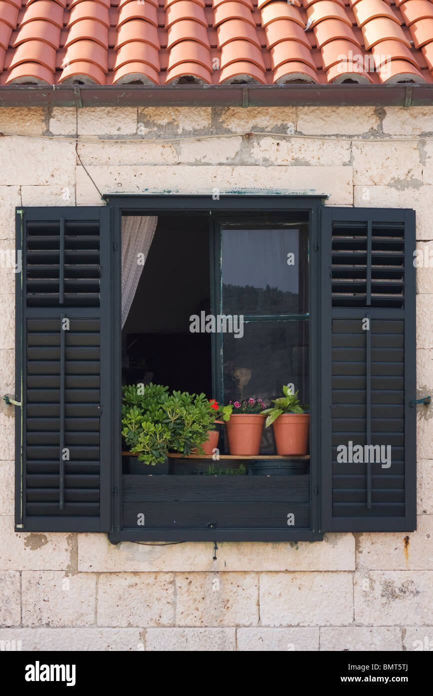 Open window with black shutters in Dubrovnik, Dalmatia, Croatia Stock Photo
