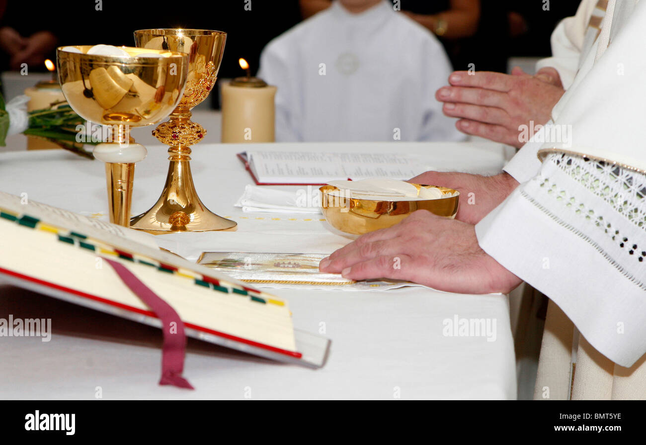 hands of priest by the mass - Stock Image