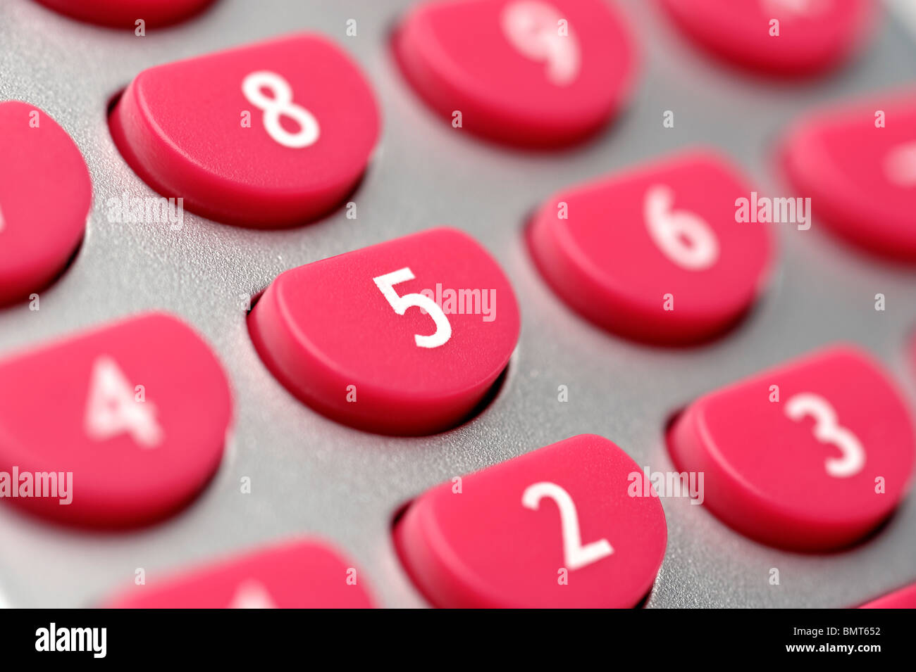 Pink calculator buttons - Stock Image
