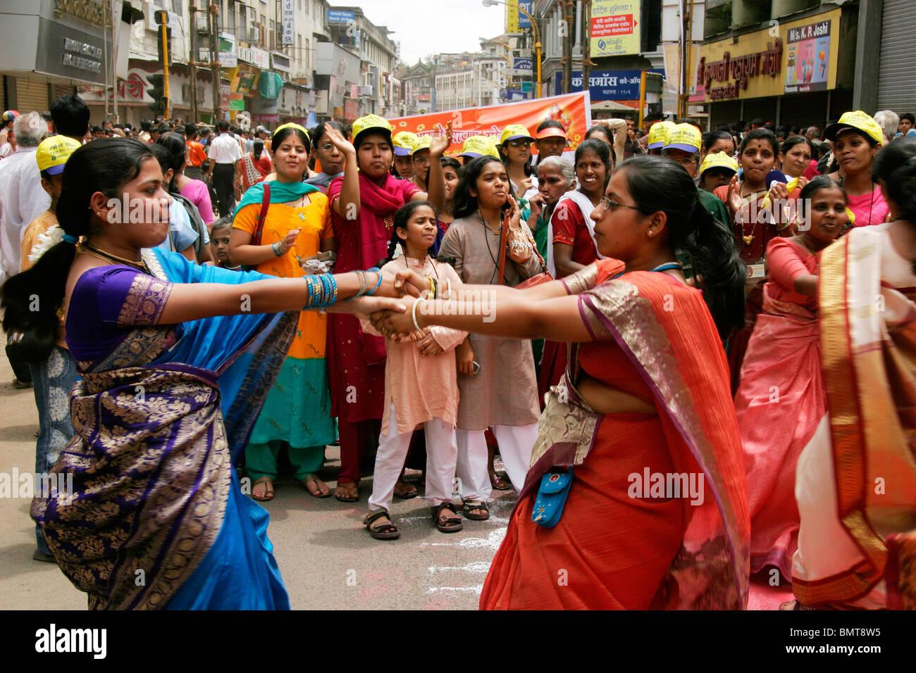 Celebrations during the immersion festival of lord Ganesh ganpati  elephant headed god NO MR ; Pune ; Maharashtra - Stock Image