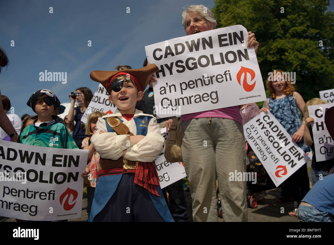 A protest by members of the Welsh Language Society against closure of small rural schools, at the Urdd Eisteddfod - Stock Image