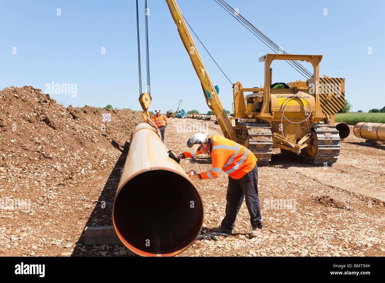National Grid natural gas pipeline being laid, seen here crossing the Cotswolds near Elkstone, Gloucestershire Stock Photo