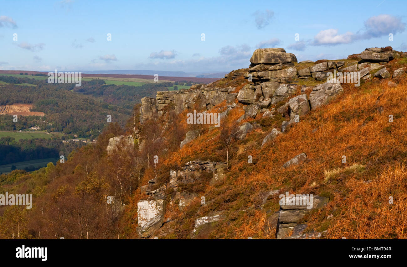 Rocks at the summit of Curbar Edge in the Peak District National Park in Derbyshire England UK with blue sky - Stock Image