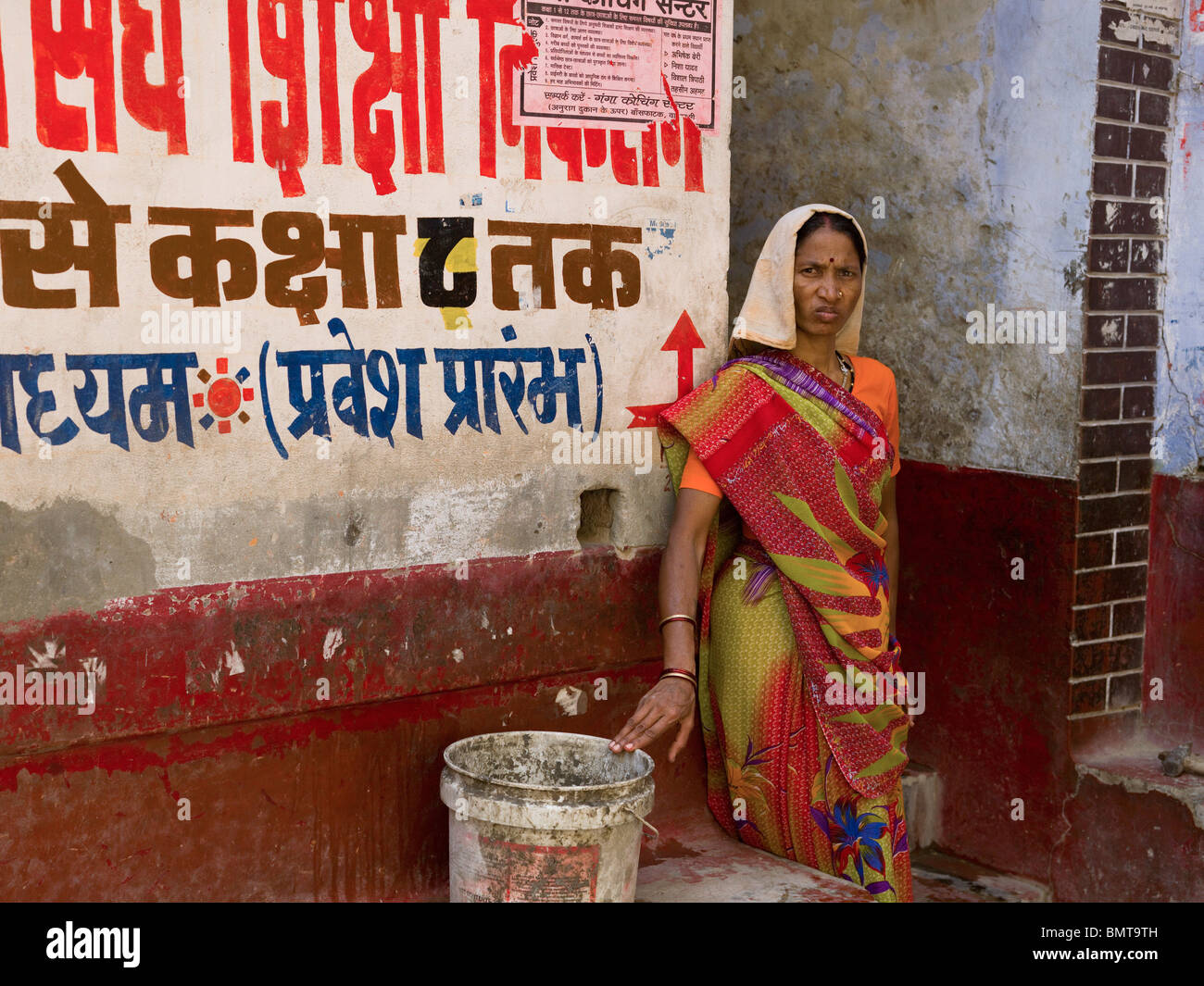 Varanasi,India;Portrait Of A Woman Outside A Shop Front - Stock Image