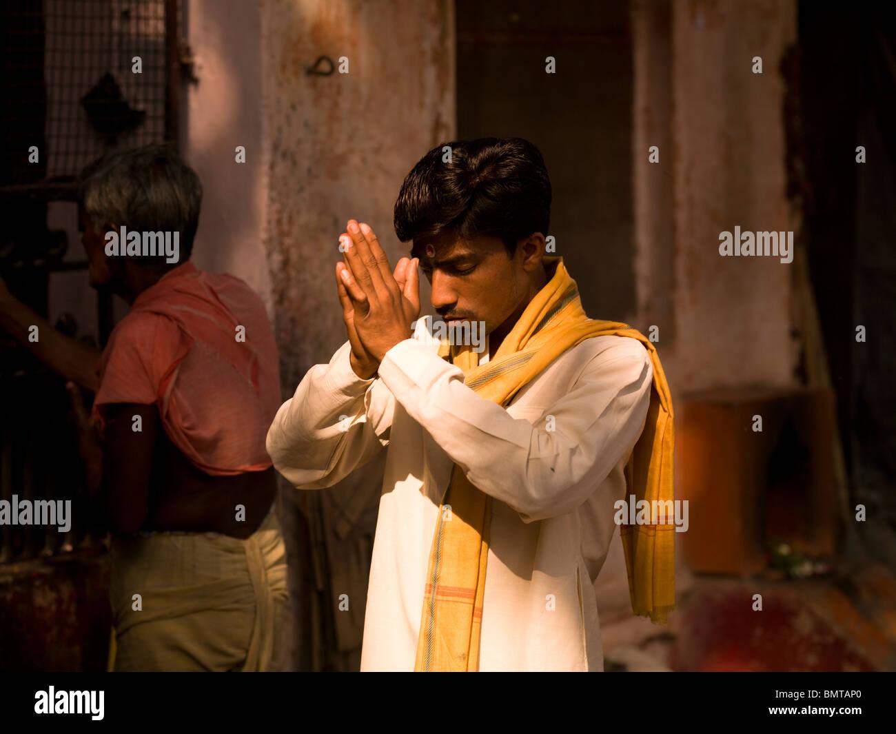 Varanasi,India;Man Praying In Temple - Stock Image