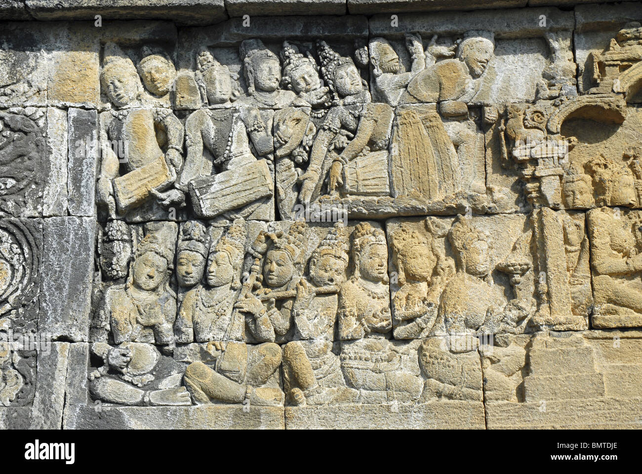 Indonesia-Java-Borobudur, Third Terrace, Musicians (few playing Drums and flute). - Stock Image