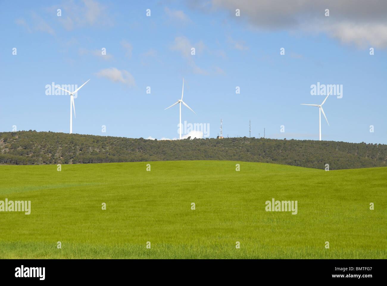 view over wheat fields to aerogenerators on the horizon, near Huete, Cuenca Province, Castile-La Mancha, Spain - Stock Image