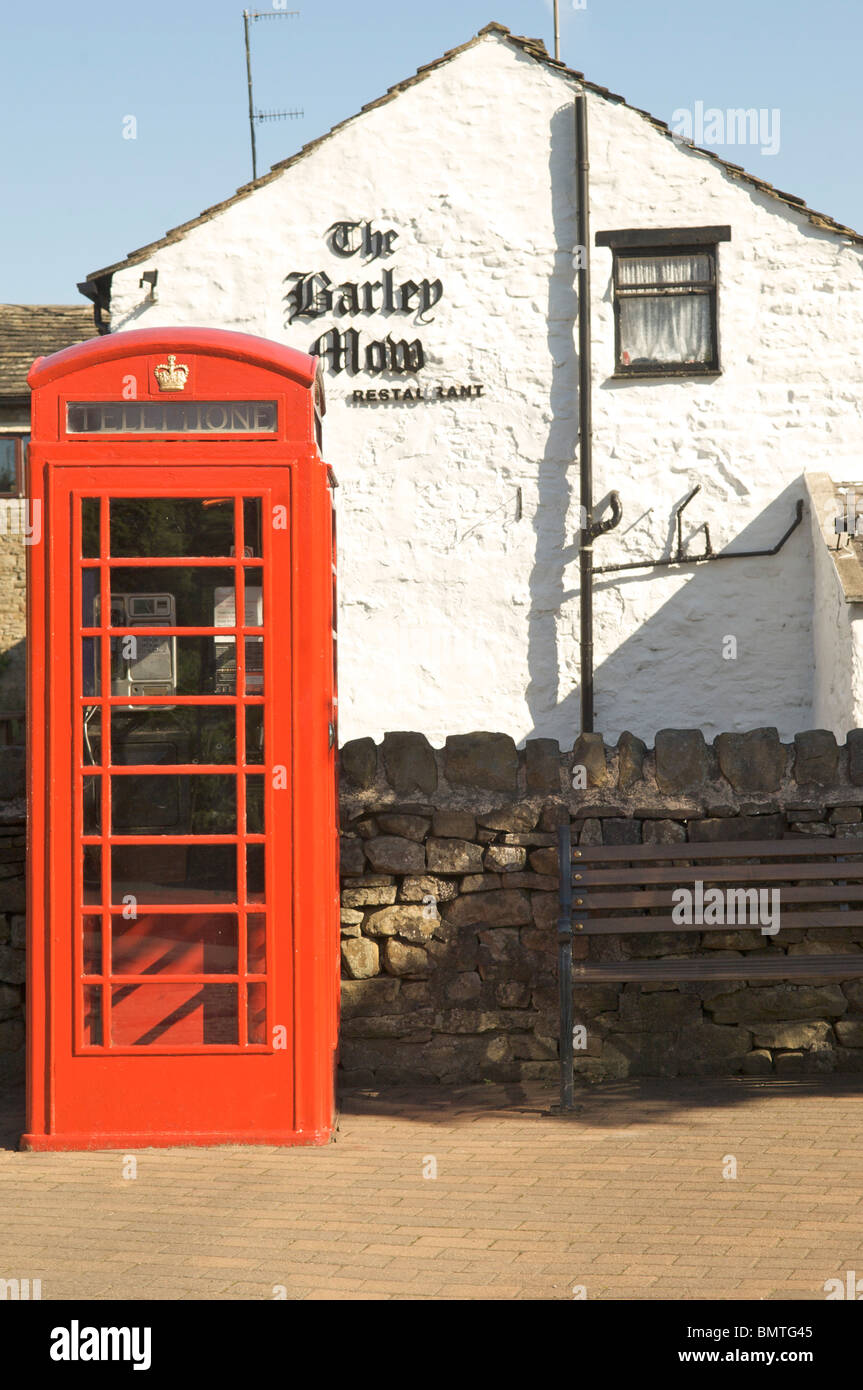 Red telephone box in front of the Barley Mow pub,Barley village,Pendle,Lancashire,England - Stock Image