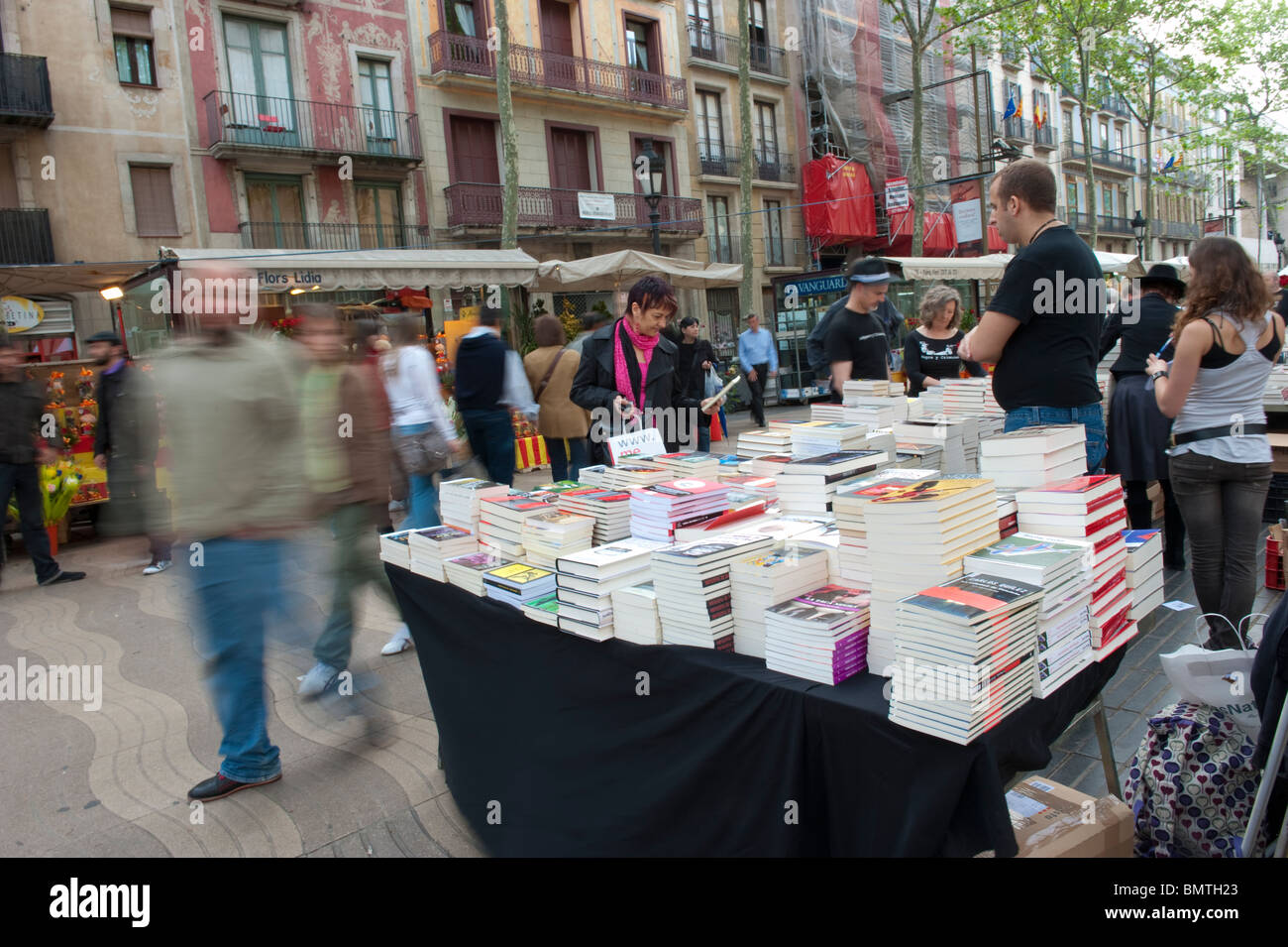 View of a book stall in Las Ramblas of Barcelona as part of the tradition of Sant Jordi. - Stock Image