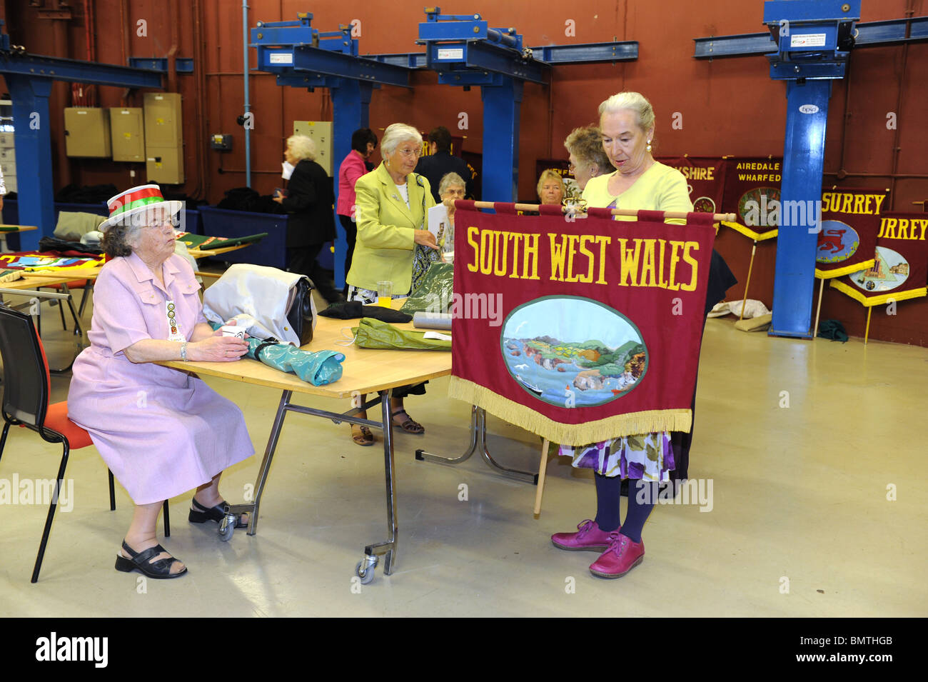 Members of the Townswomen's Guild preparing for the parade of banners at their annual conference - Stock Image