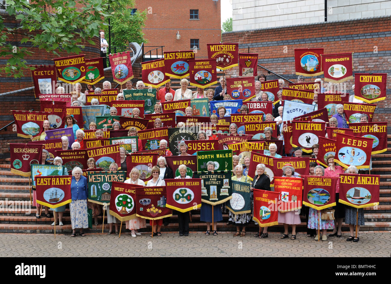 Members of the Townswomen's Guild after the parade of banners at their annual conference - Stock Image