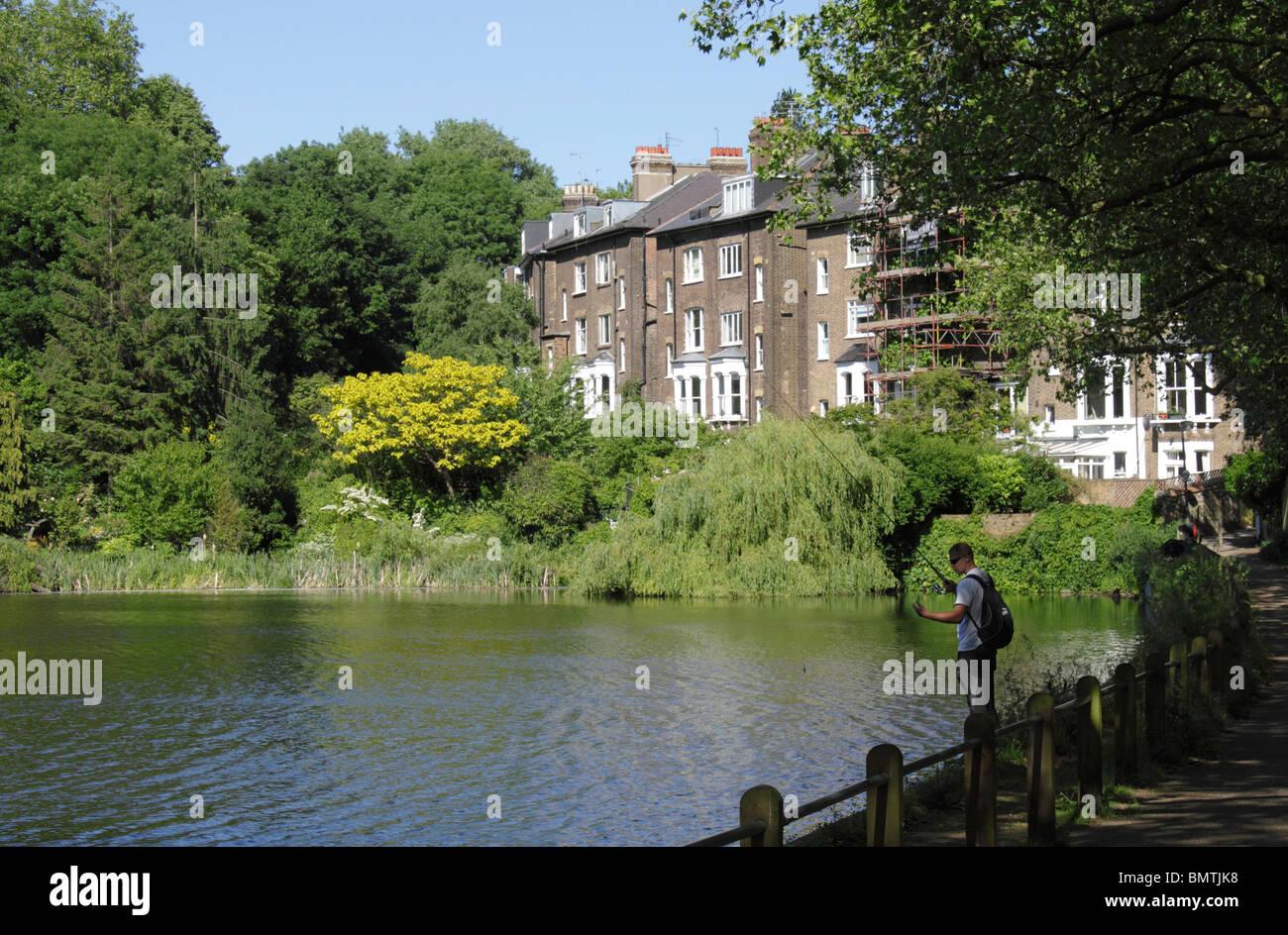 Man fishing Highgate ponds Hampstead Heath London Stock Photo