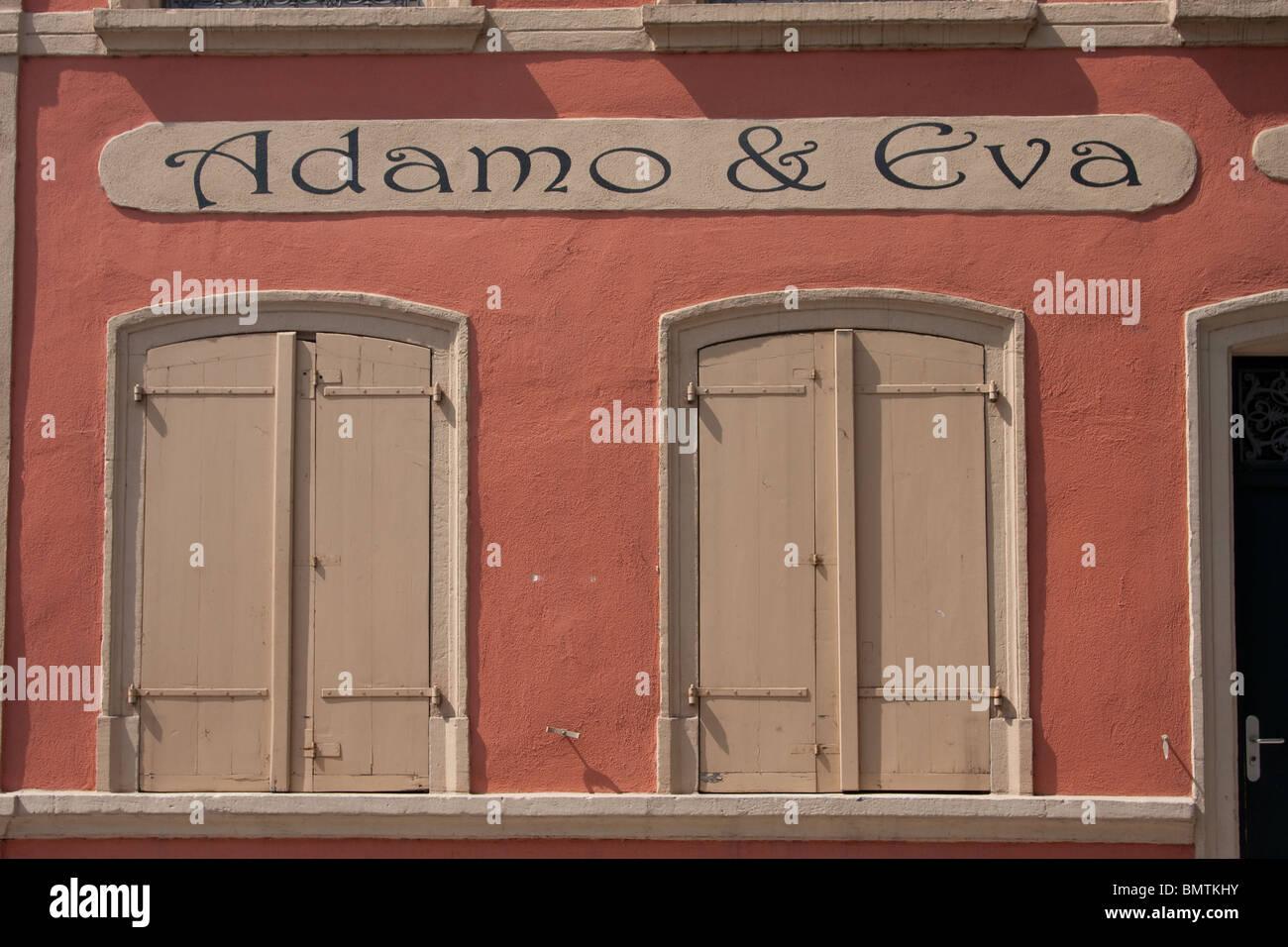 elegant shop sign shuttered windows pink wall - Stock Image