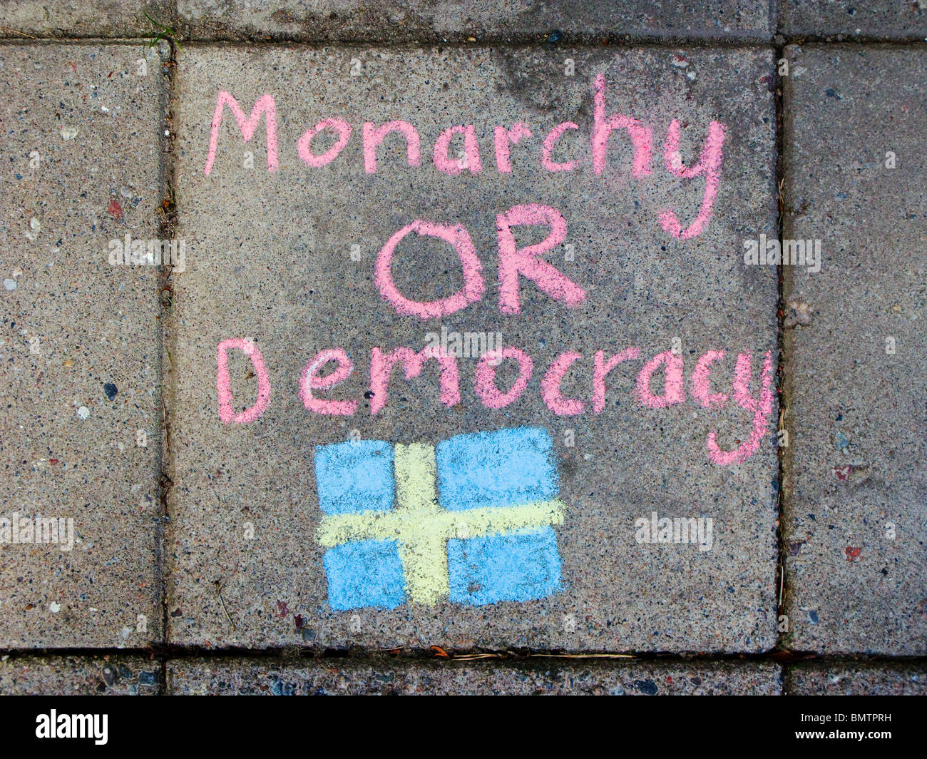 Monarchy OR Democracy - text written on paving stones, as a silent protest against the Swedish Crown princesss wedding - Stock Image