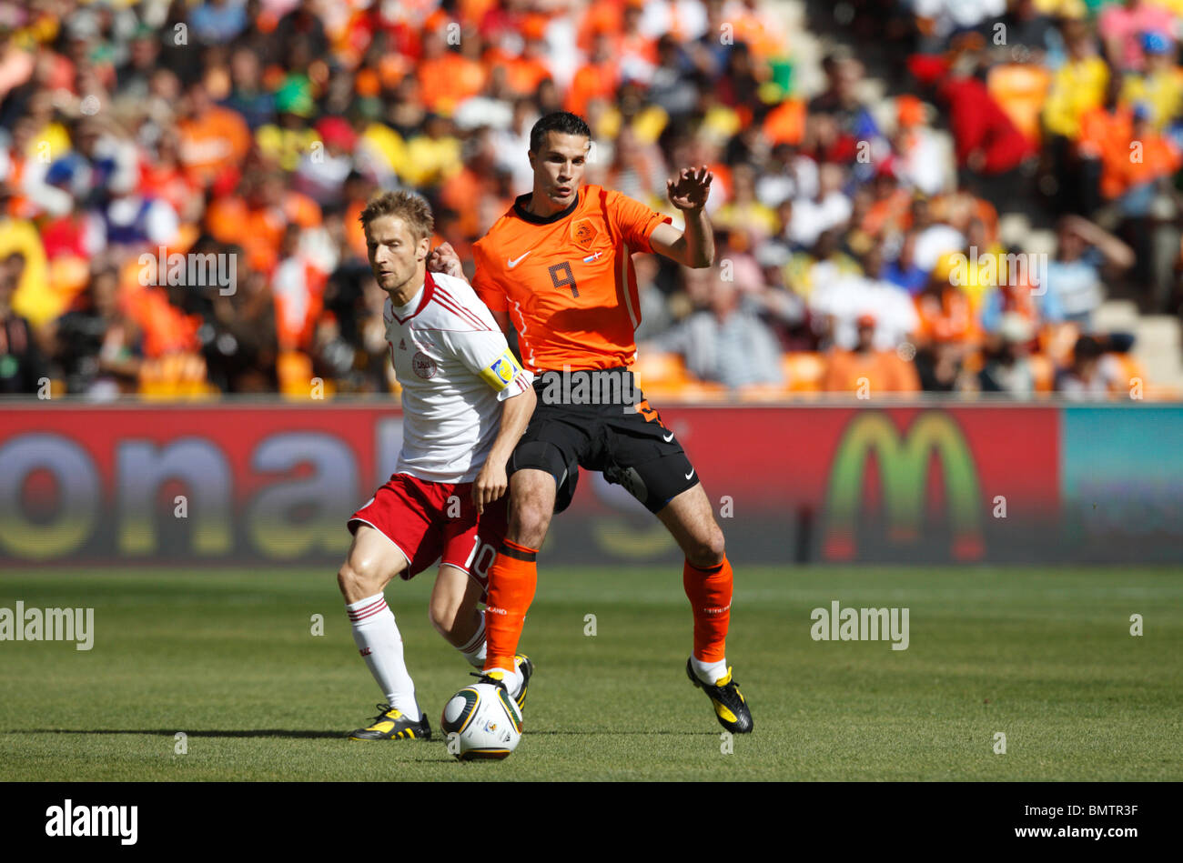 Martin Jorgensen of Denmark (l) and Robin Van Persie of the Netherlands (r) fight for the ball during a 2010 World Stock Photo