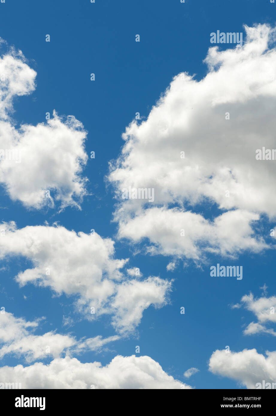 Blue skies with clouds - Stock Image