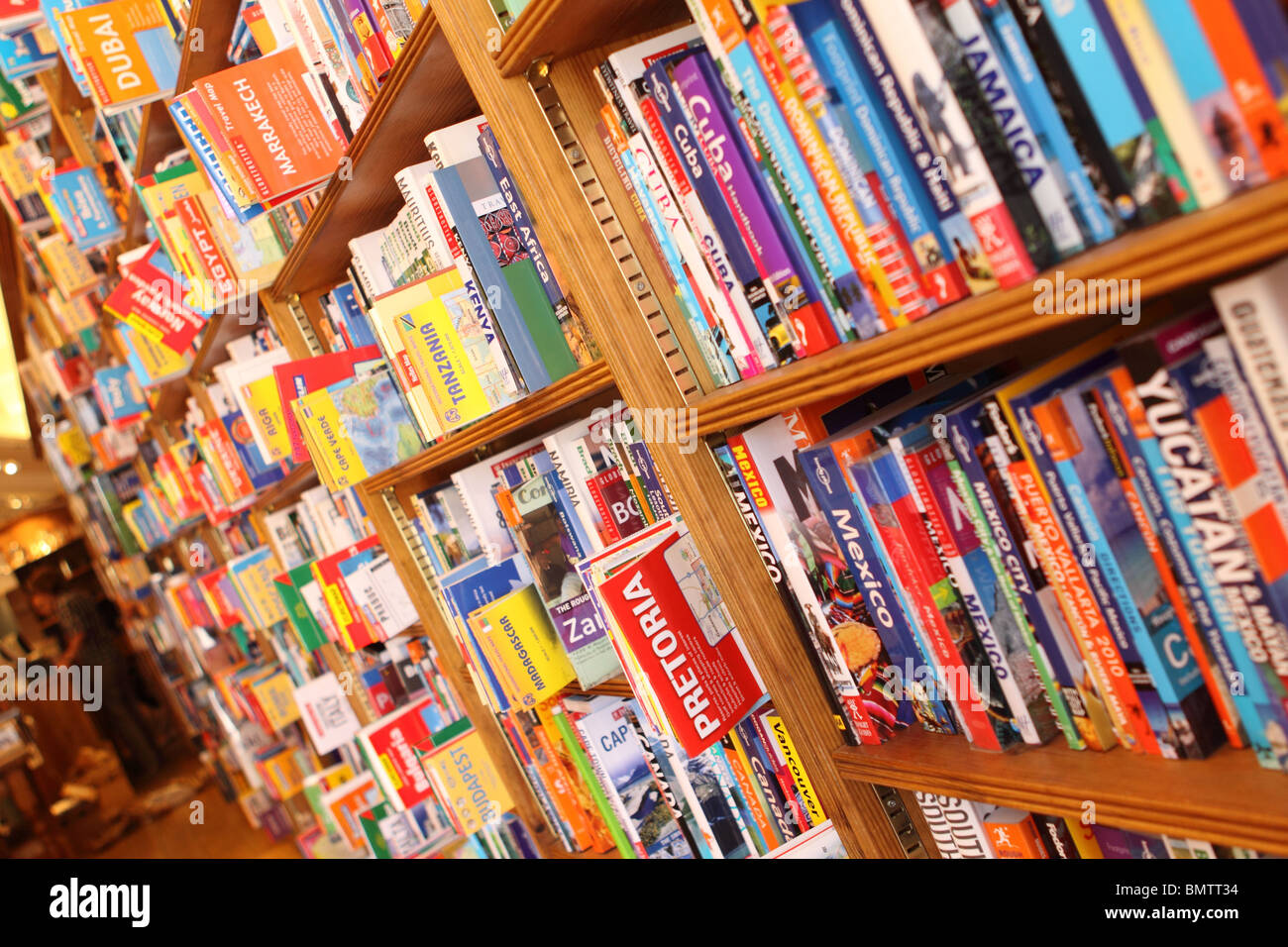 Bookshop travel guide books and tourist maps in independent bookstore - Stock Image