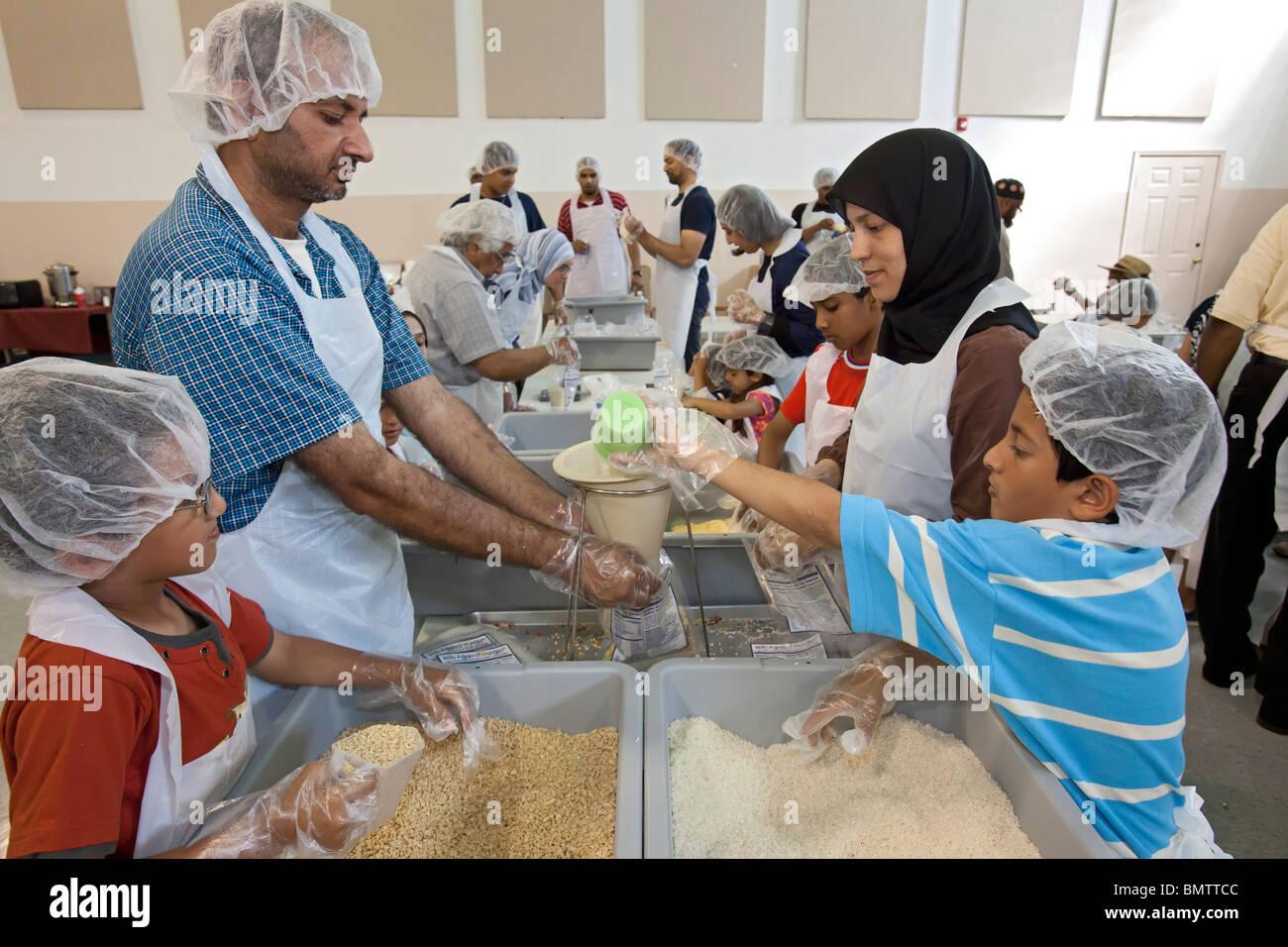 Muslim Volunteers Pack Food for Families in Need Stock Photo