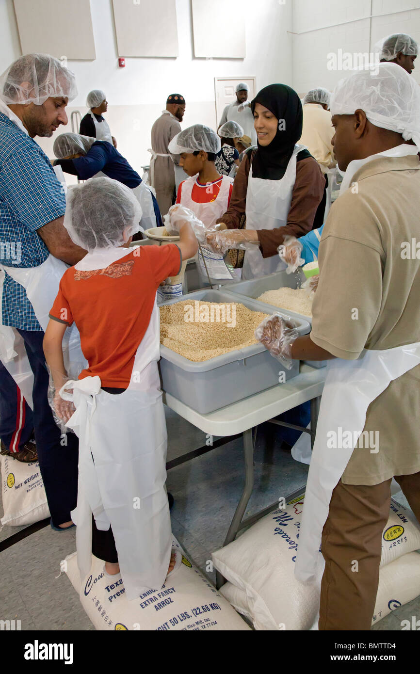 Muslim Volunteers Pack Food for Families in Need Stock Photo