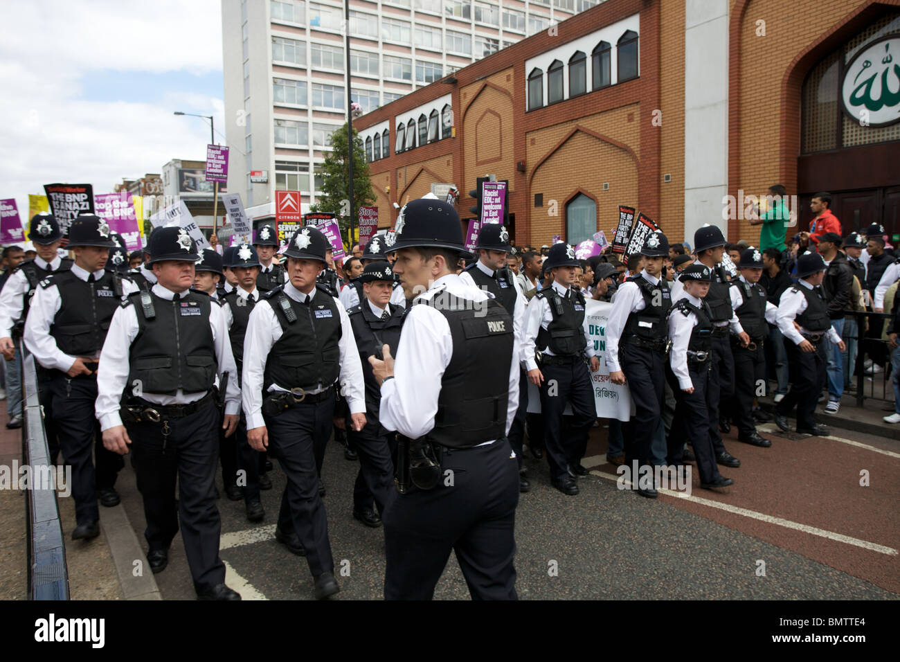 Anti fascist protest march through east London, England, UK. - Stock Image