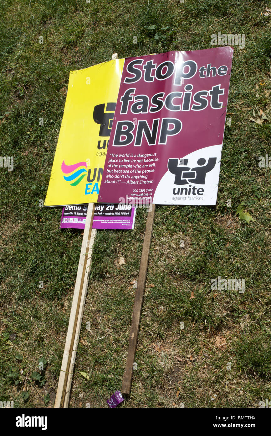 Anti BNP placards left in on the grass on Stepney Green during protest against the BNP and EDL in East London. - Stock Image