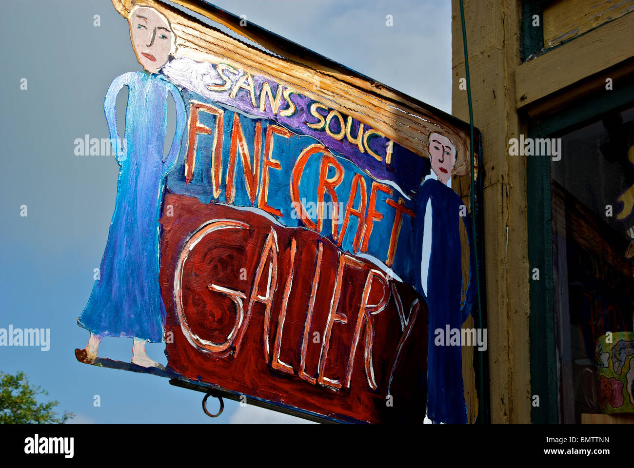 Funky Handcrafted Hand Painted Metal Sign In Front Of Sans Souci
