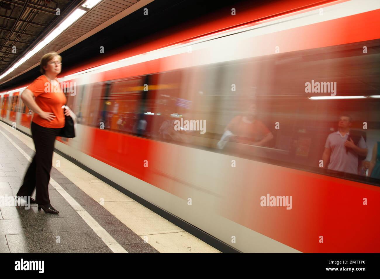 woman on platform of S-Bahn station Stock Photo
