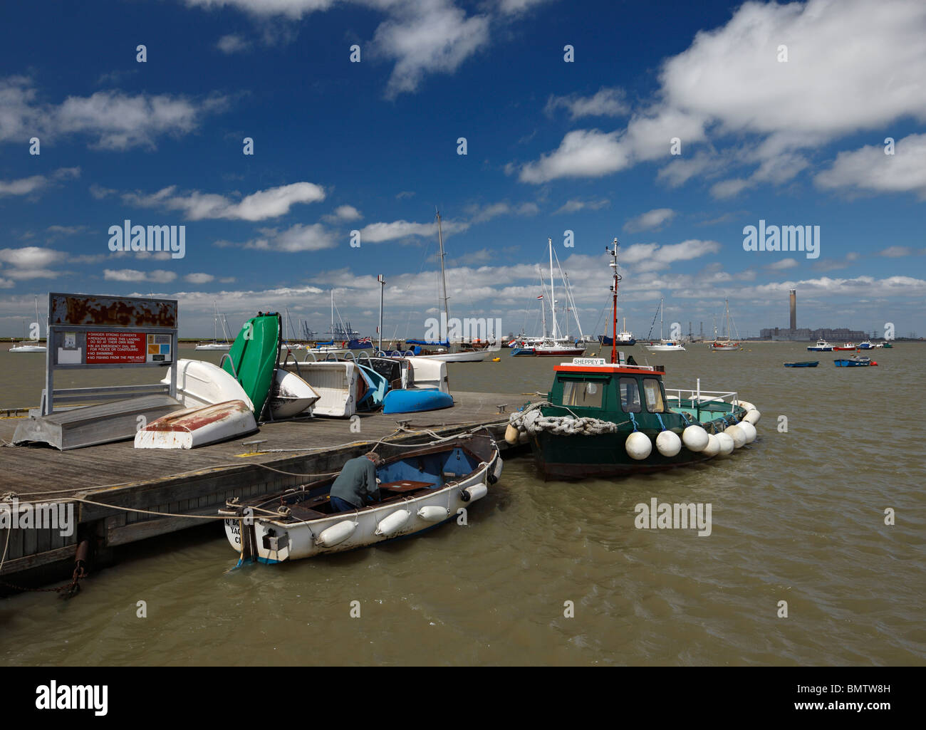 Queenborough yacht club jetty and boats. - Stock Image
