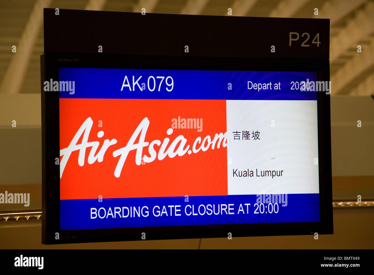 Airasia check in desk sign chek lap kok airport - Stock Image