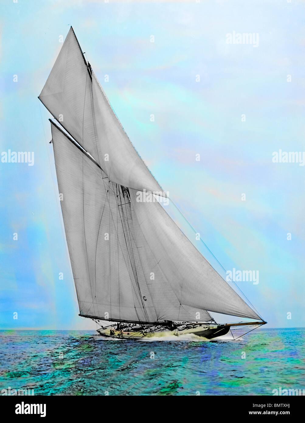 Hand tinted photograph of yacht at full sail - Stock Image