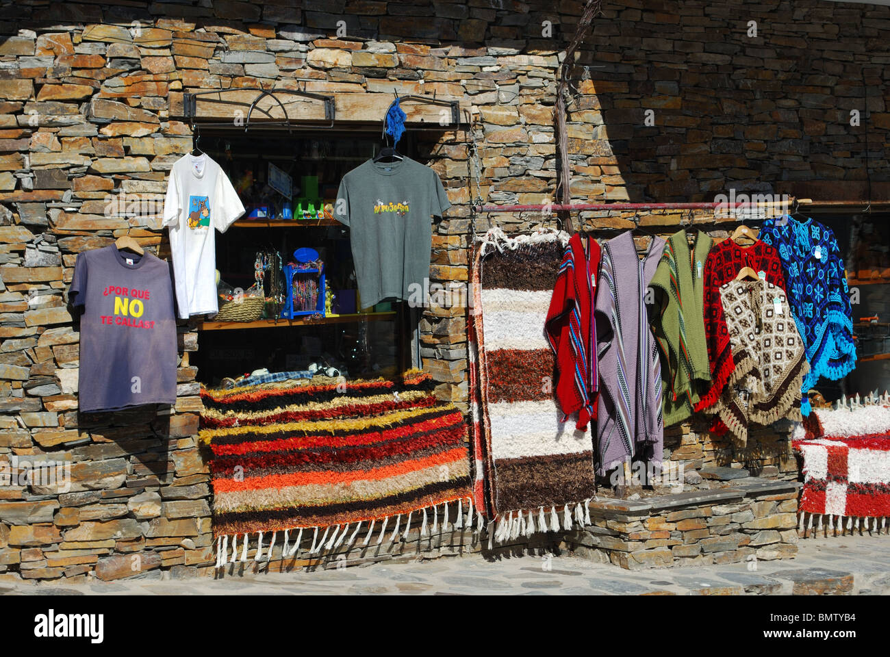Shop selling locally made rugs and ponchos, Trevelez, Las Alpujarras, Granada Province, Andalucia, Spain, Western - Stock Image