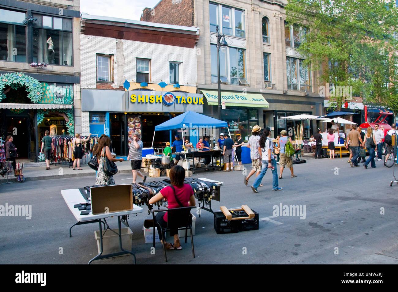 Sidewalk sale Boulevard Saint Laurent Montreal - Stock Image