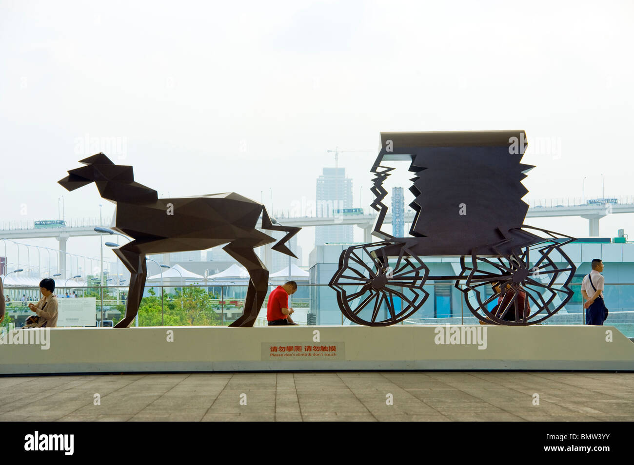 EXPO 2010 Shanghai china ART work of art statue iron rust rusty modern times contrast opposit mail coach stagecoach - Stock Image