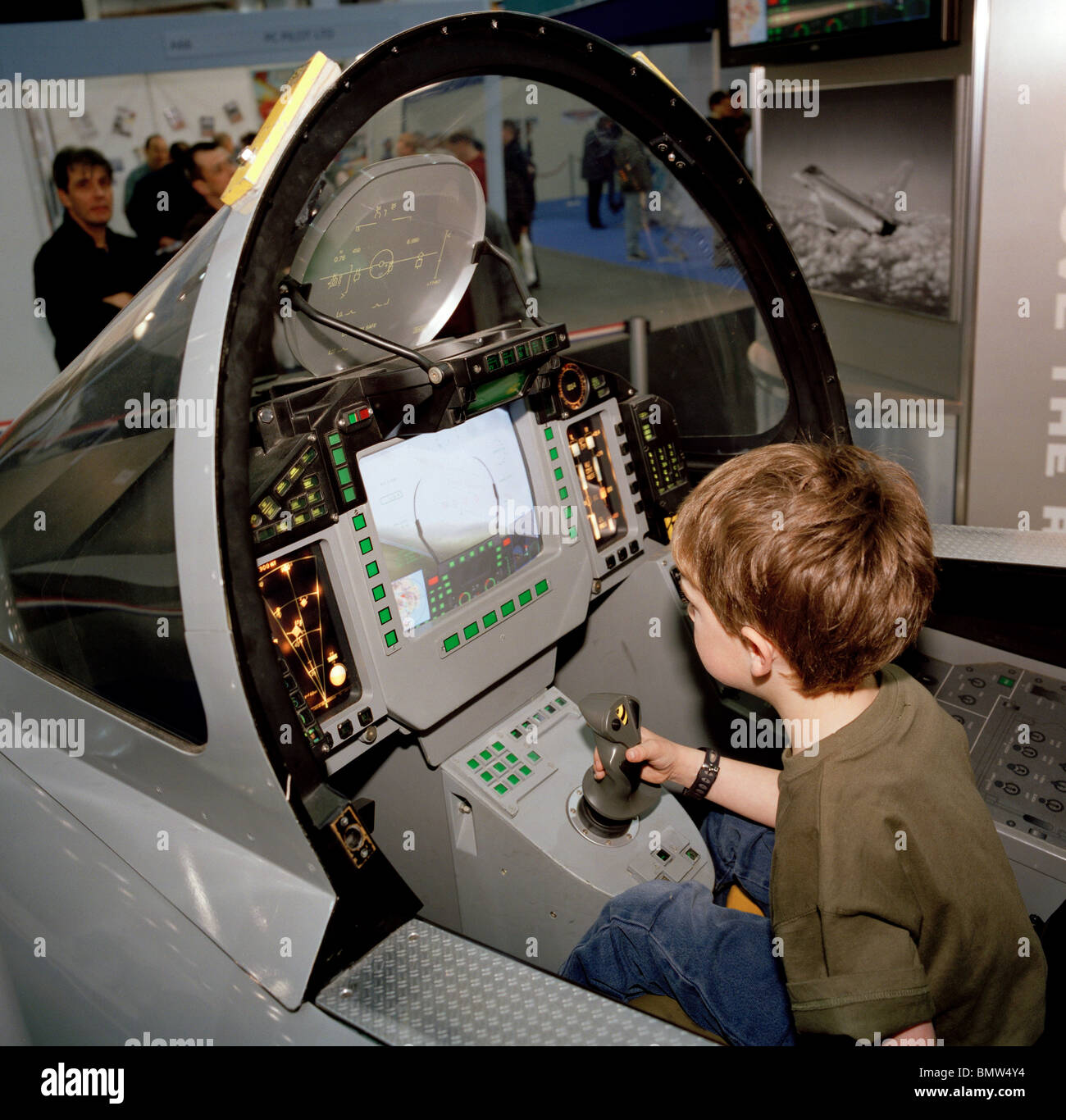 A Young Boy Sits In Bae Systems Typhoon Model Cockpit Stock Photo