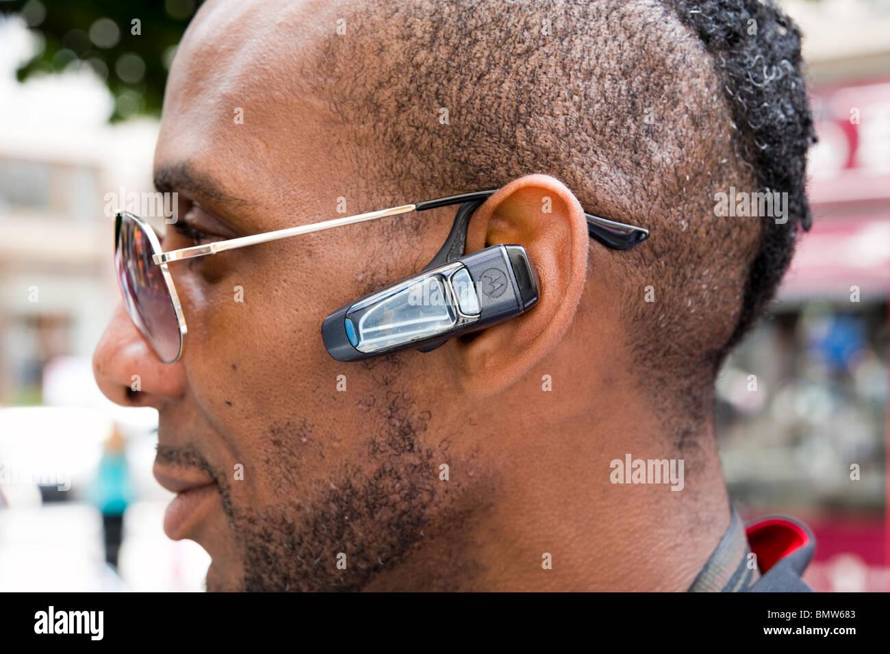 Bluetooth mobile phone headset, London, England, Britain, UK - Stock Image