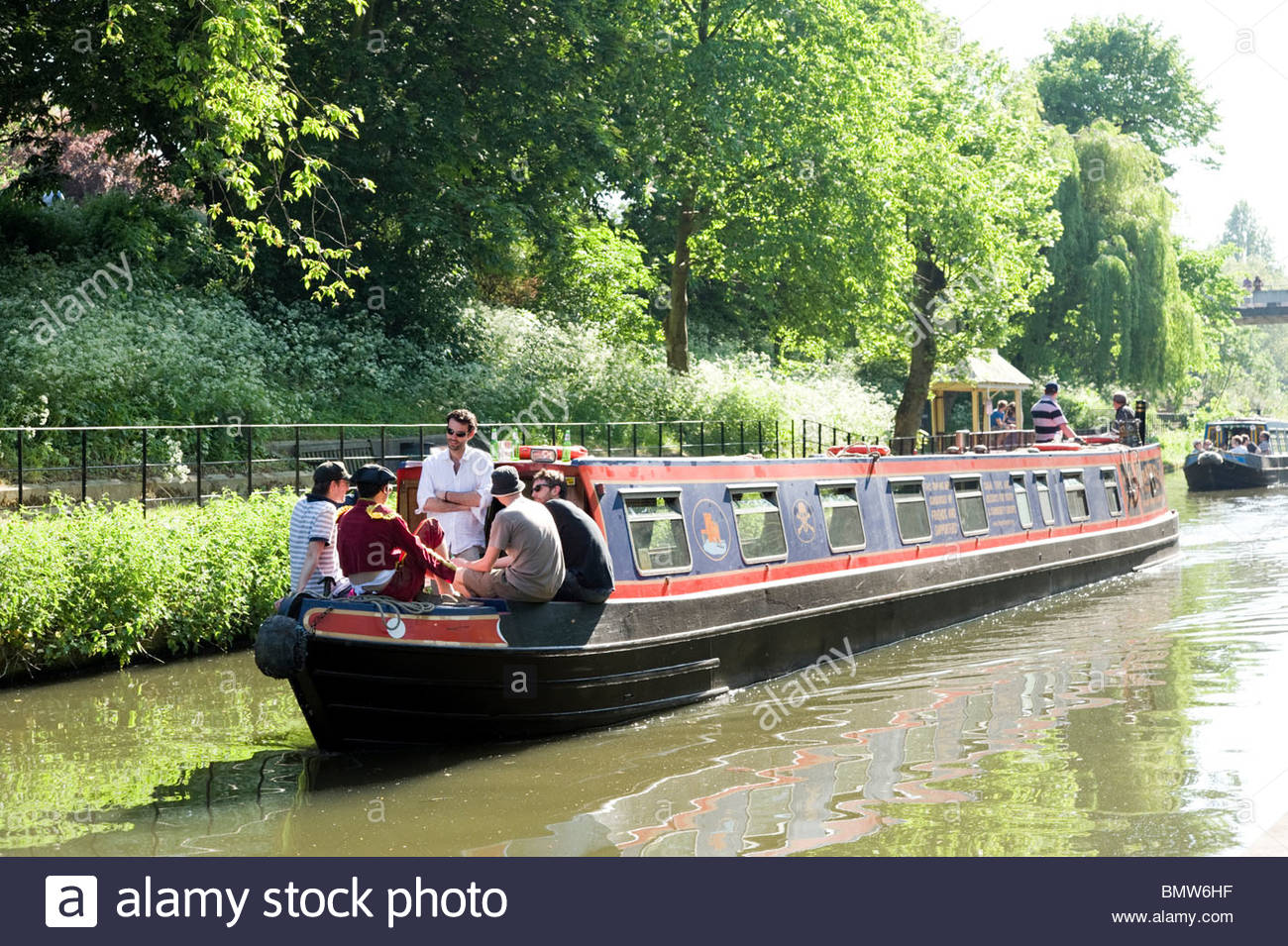 Narrowboat travelling down the Regent's Canal in London, England, UK - Stock Image