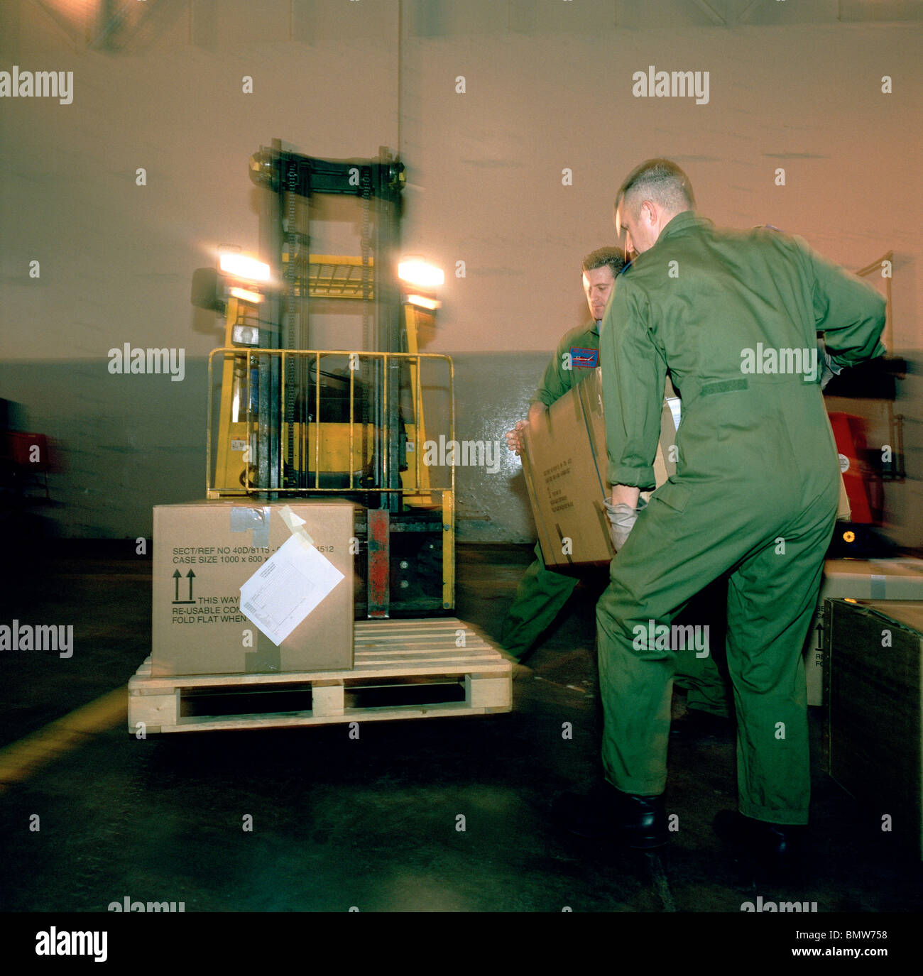 Loading boxes packed with the possessions and kit belonging to the elite 'Red Arrows' personnel in their - Stock Image