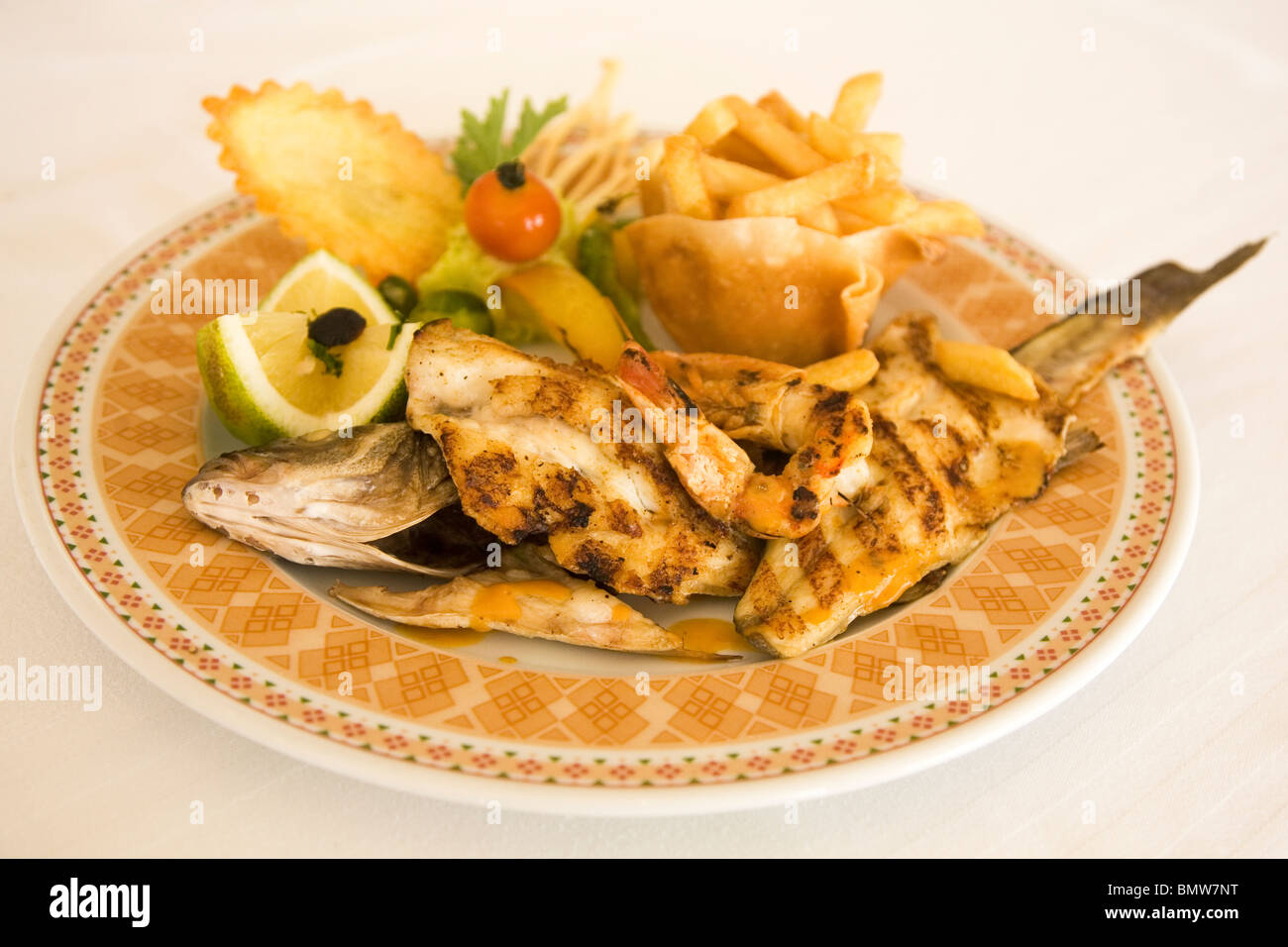 A well-presented seafood platter is served in a restaurant within one of the luxury hotels in Djerba, Tunisia. - Stock Image