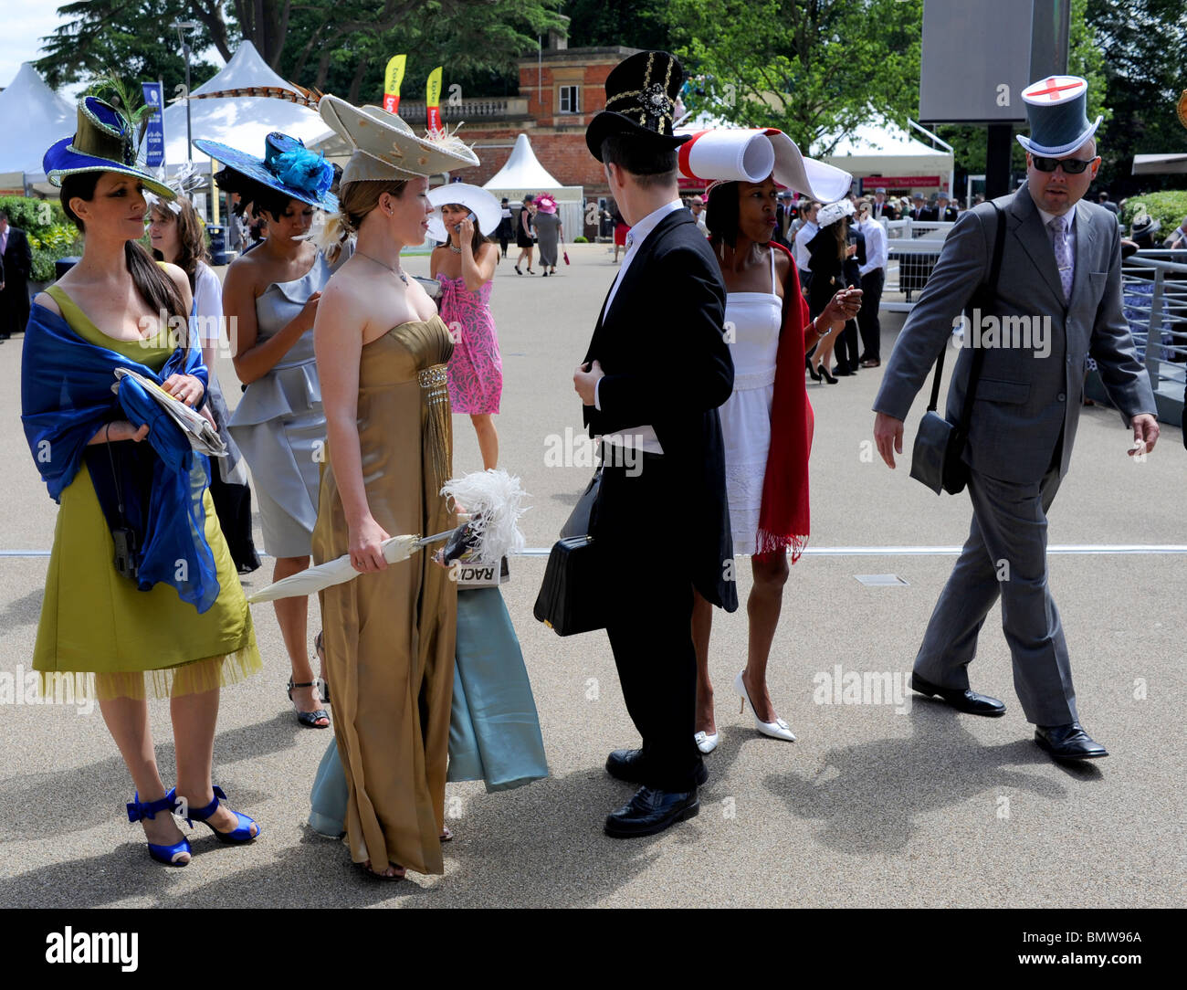 Royal Ascot racegoers in fashion outfits Berkshire UK - Stock Image