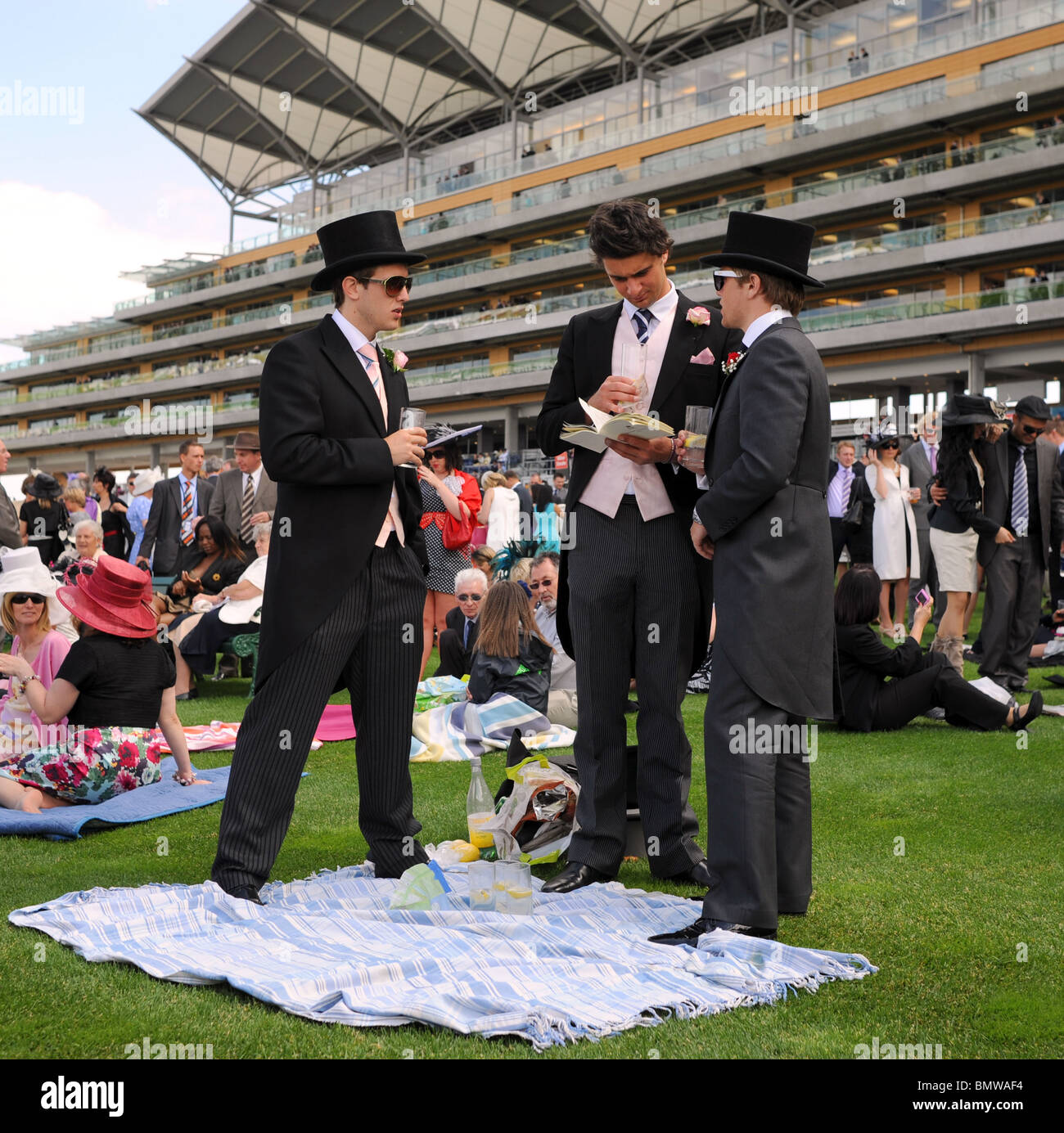 Royal Ascot Horse racing Berkshire - Racegoers wearing Morning Suits in front of the Grandstand - Stock Image