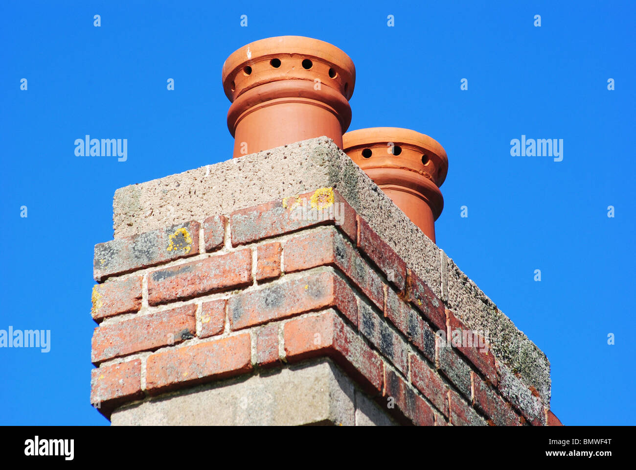Chimney Stacks on a Sunny Day. - Stock Image