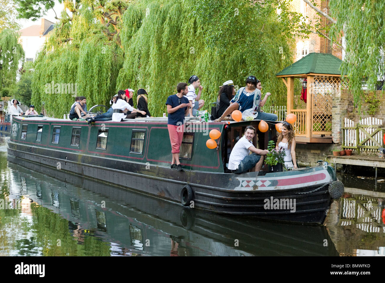 Narrowboat travelling down the Regent's Canal in Camden, London, England, UK - Stock Image
