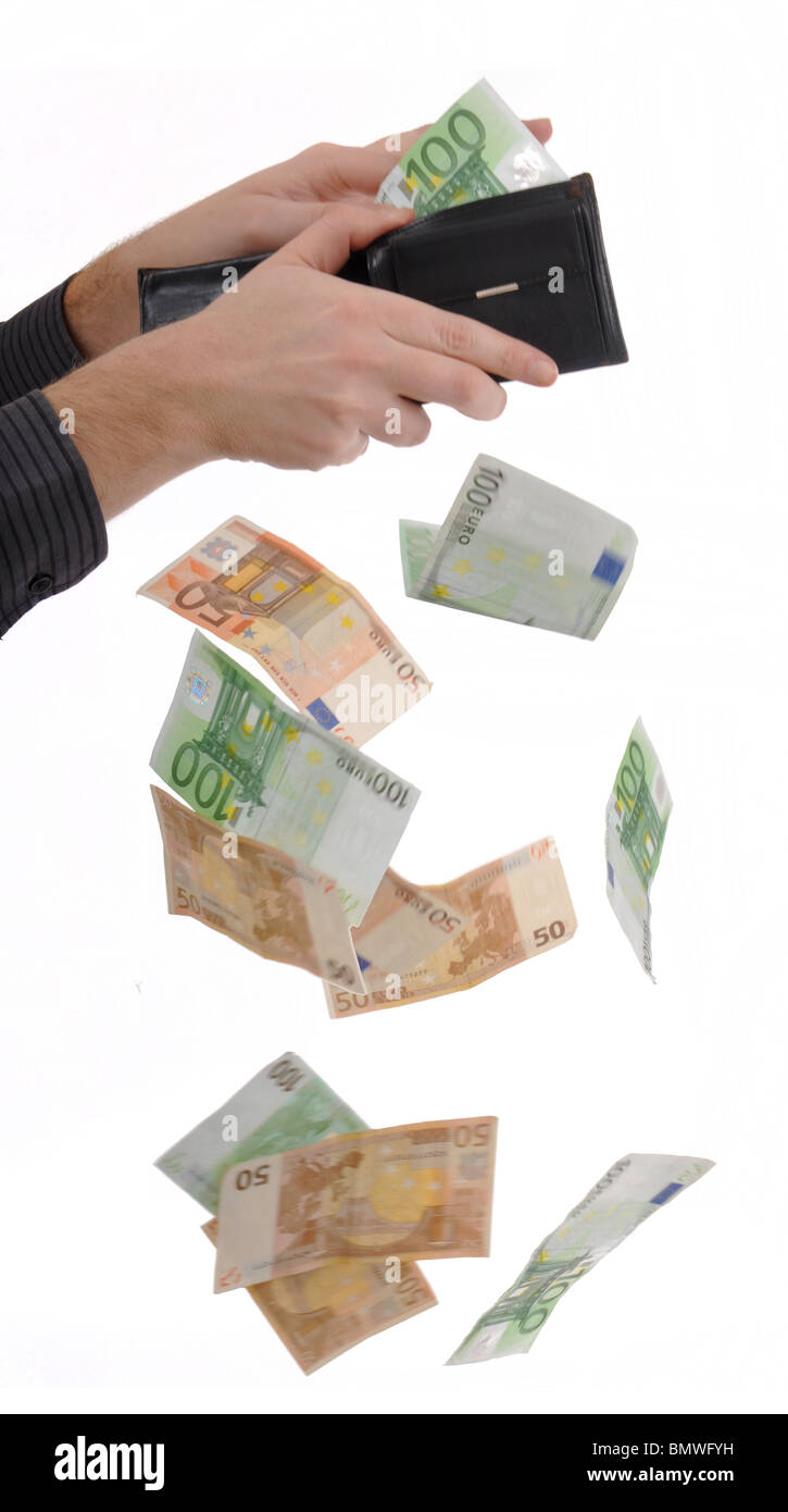 Man is paying with euro banknotes, money falling out of the pocket - Stock Image
