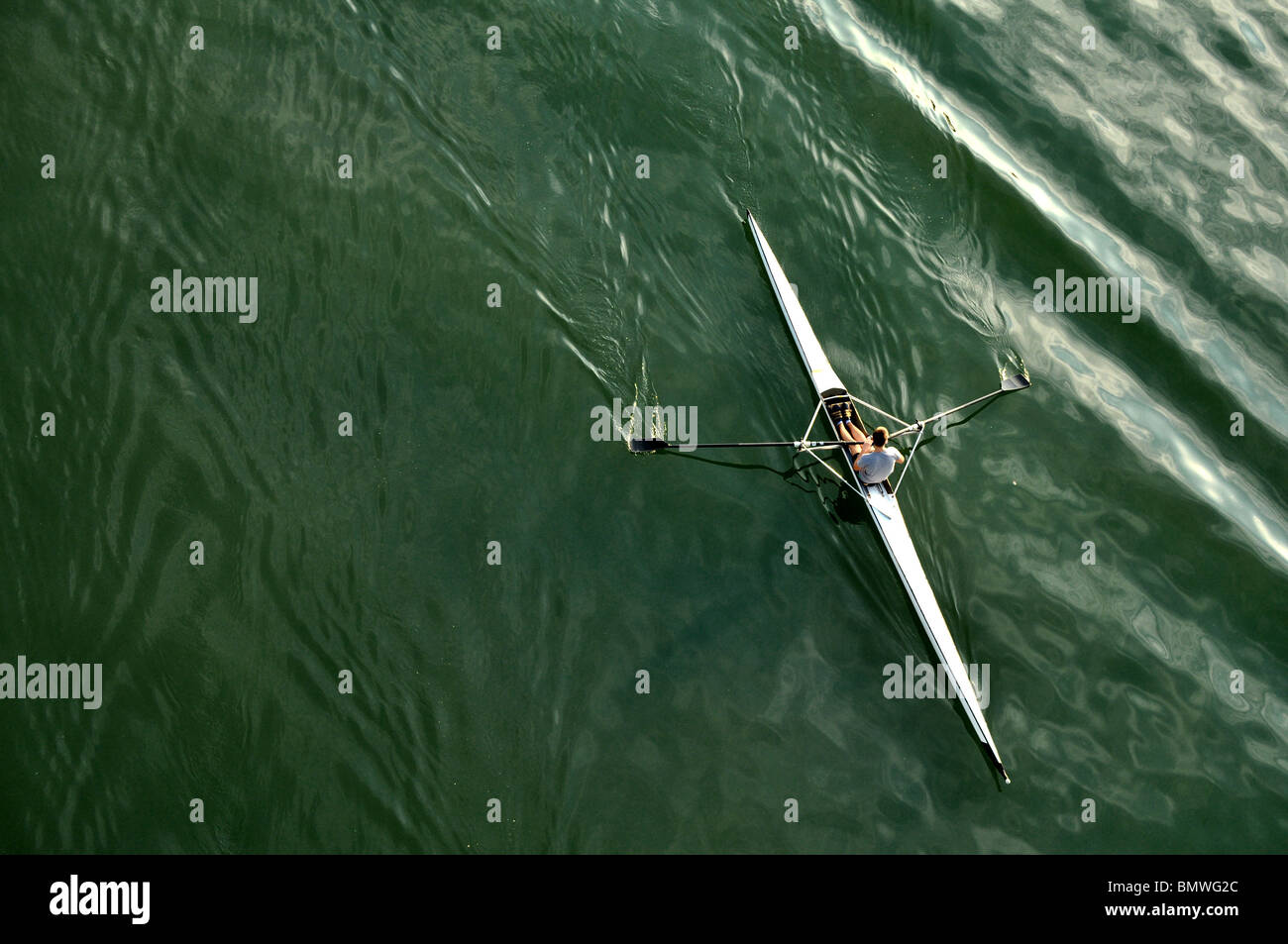 image of a young man rowing in kayak down the river - Stock Image