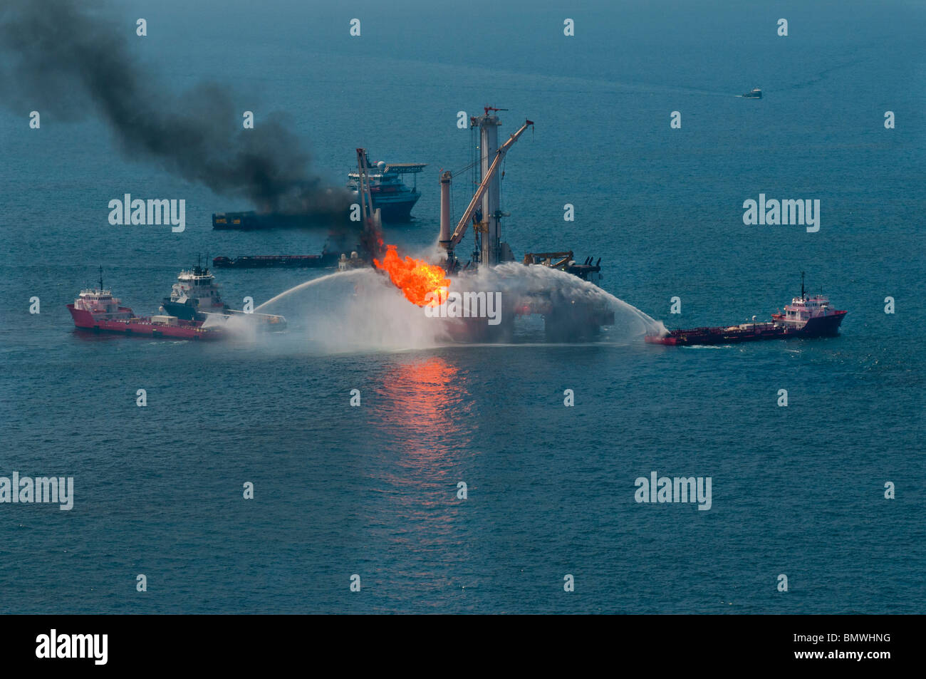 Helix Q4000 burning oil at the MC252 site, Gulf of Mexico, USA. - Stock Image