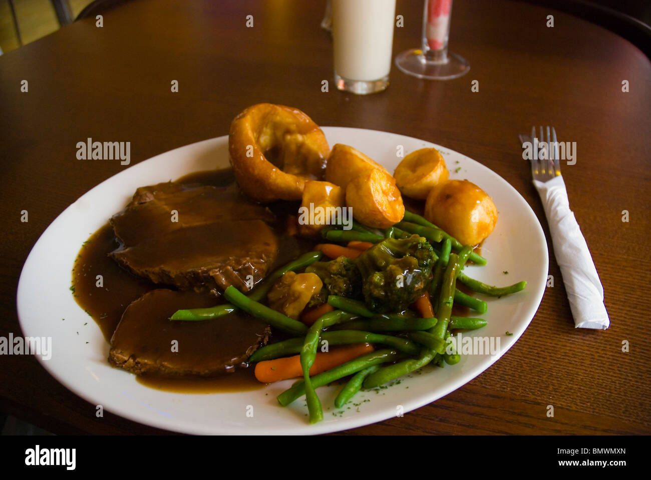 Sunday Roast with beef roasted potatoes and vegetables in a restaurant in Liverpool England UK Europe - Stock Image