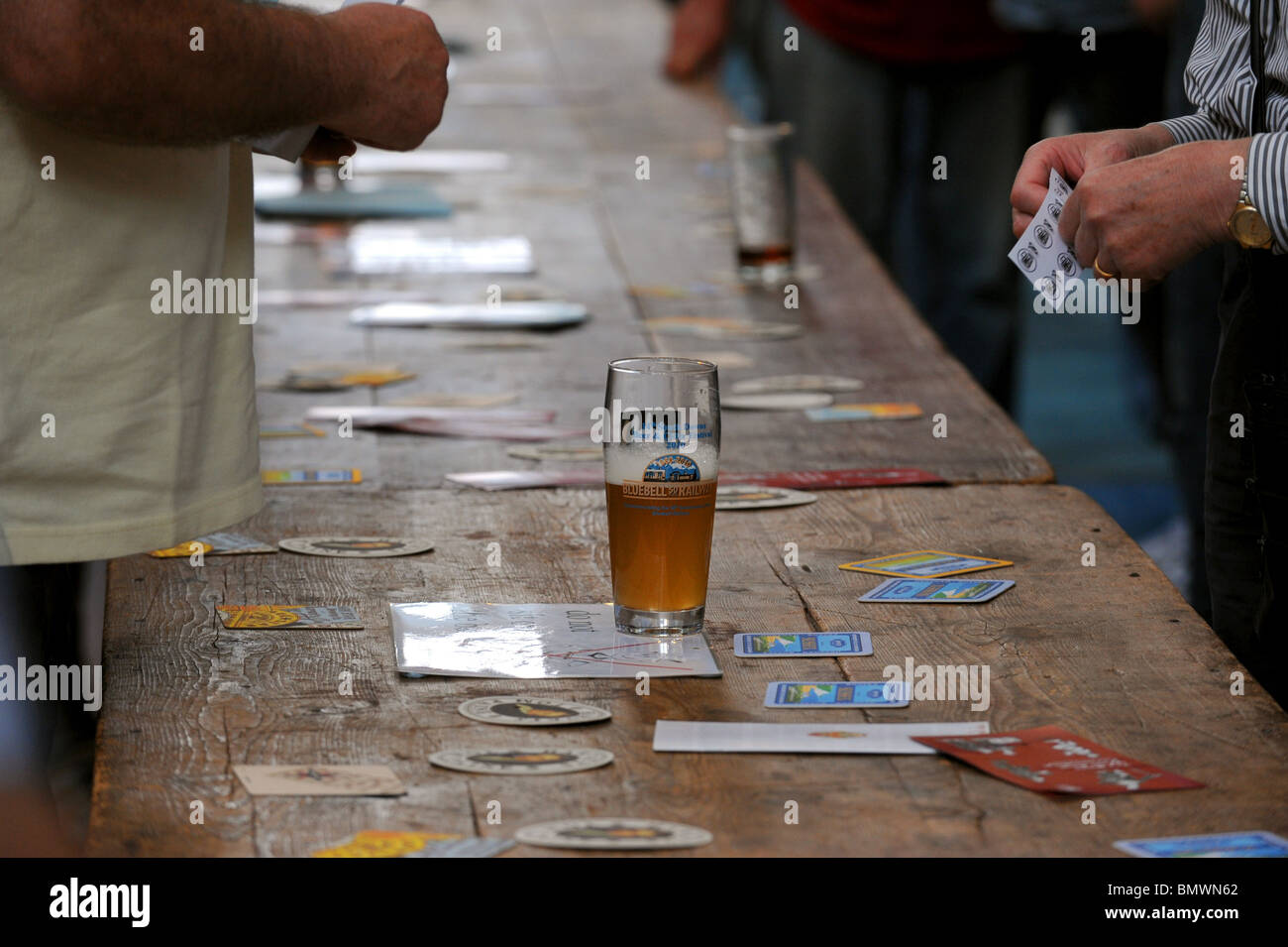 Pint of beer on a table at Southdown Beer and Cider Festival at Lewes UK - Stock Image